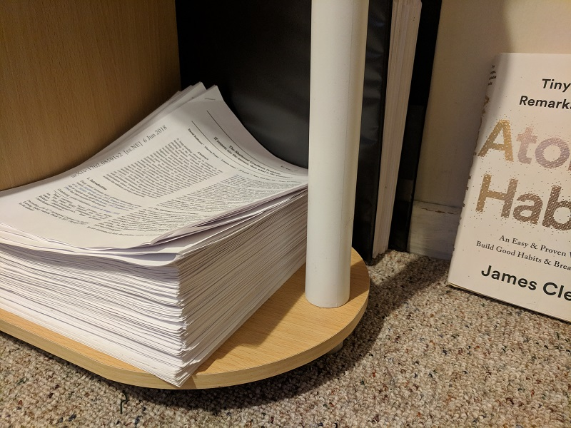 Stack of read papers.